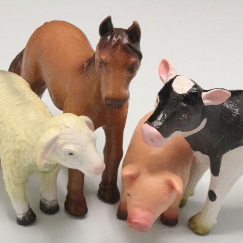 boerderijdieren in close-up met grijze achtergrond