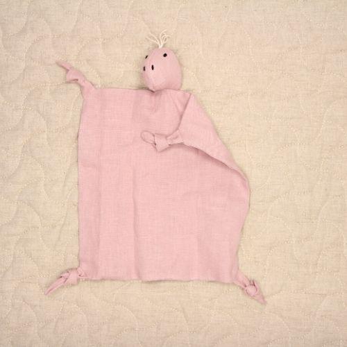 dino knuffeldoekje roze op roze achtergrond met speelmat