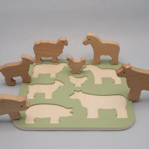 puzzel boerderijdieren op grijze achtergrond